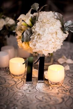 Event design by Florabella Studios; Florals by Driftwood and Roses; Votives by Glassybaby.