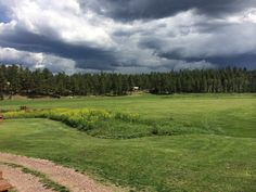 Alpine Country Club, in the cool pines of NE Arizona.  This is a view of where a ceremony was to be held in August 2014 (but was moved inside because of the weather you see in the sky.)