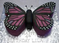 Monarch Butterfly - This cake is for a 4 yr old girl but her mother wanted a more realistic design rather than childish. Carved from 2 layer 12 x 18 sheet cake, covered in fondant and airbrushed. :-)