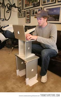 funny table made of MacBook computers