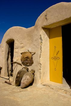 Africa | A bright yellow door in Tunisia | by Laura Ponchia | repinned by BroCoLoco.com
