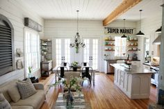 Love this farmhouse kitchen that opens to a family room.  Simple, airy and lovely! ♥