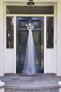 Bridal Bouquet Door Decor. Use bouquet (fresh or silk), add tulle to look like wedding gown train...and attached to hook affixed to front door. Great look!