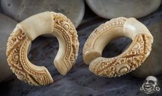 Fossilized Mammoth bone at $500!  Polymer clay, perhaps?  wood? Size 00, too big for me any way.  But good god amighty I luv em.