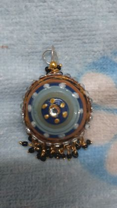 quilled blue and black art work pendant
