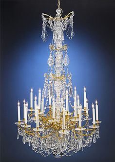 Victorian Baccarat Crystal And Dore' Bronze Twenty-Four Light Chandelier Made By The French House Of Baccarat - French   c.1880