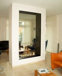 Unique vertical fireplace with contemporary furniture to accent it.