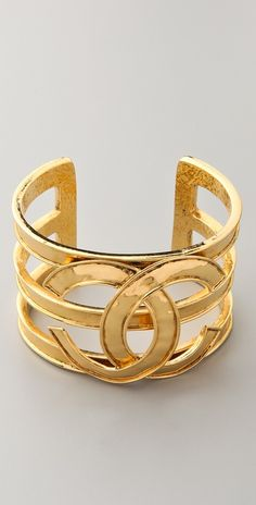 "Vintage Chanel CC Cuff *This authentic vintage Chanel gold-plated cuff features interlocking Cs at the bar details. * 1.75"" (4.5 cm) wide. * 2.5"" (6 cm) diameter. * Made in France. * NOTE: This is an authentic vintage piece. Gentle wear is to be expected."