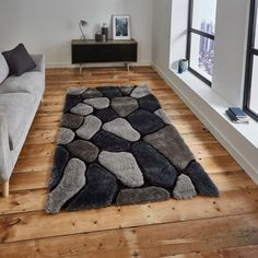 This Noble House Grey/Cobalt Rug By Think Rugs is hand tufted in acrylic and soft polyester. With a multi textured pile, Grey is a stunning rug with a striking pebble design in varying shades of grey. Shag Pile Rugs, Shaggy Rugs, Selling Design, Living Room Color Schemes, Custom Rugs, Home Rugs, Grey Rugs, Rugs Online, Houses