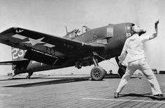 U.S. Navy sailors on the escort carrier USS Kasaan Bay launch a Grumman F6F-5 Hellcat of Fighting Squadron 74 (VF-74) during the invasion of Southern France. (U.S. Navy Photograph.)