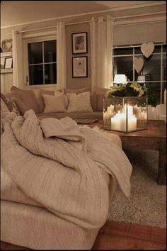 Love all the pillows, the neutrals, & the candles.  Clean, uncluttered, cozy space.  ♥