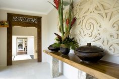 From Bali With Love: Indonesian Inspired Home Decor (From Bali With Love)    carved wood entrance way  perhaps the pop up tv console cane be created from a carved paneled piece...