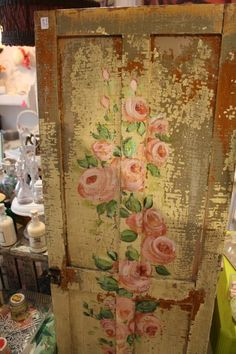 I love the roses on the chippy door !...This would be sooo awesome on my kitch doors, bath doors,closet door,hmmm where else?