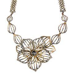 CUT OUT FLOWER + PETAL COLLAR NECKLACE. Available at: www.chloeandisabel.com/boutique/davenaellis