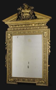 A Giltwood Mirror. Unknown maker, English. Late eighteenth/early nineteenth century.
