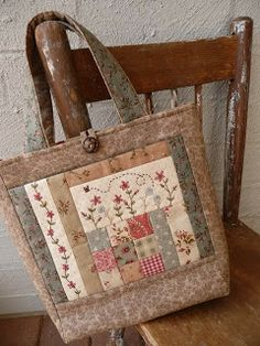 Adorable! I love this bag, but even more I LOVE the vintage look of the fabrics combined with patchwork and embroidery.