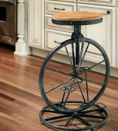 Preeeetttttyy sure I need this! Wrought Iron Unicycle Stool by CanadianWesternLife on Etsy