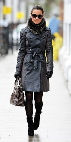 Pippa side-stepped the London rain in black strappy espadrilles, a grey-paneled trench coat by Reiss, a brown crocodile handbag by Modalu and her trusty umbrella.