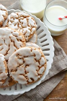 Iced Oatmeal Cookies ~~     2 cups old-fashioned rolled oats,     2 cups all purpose flour, 1 tablespoon baking powder, 1/2 teaspoon baking soda, 1/2 teaspoon salt, 2 teaspoons cinnamon, 1/2 teaspoon ground nutmeg,1 cup (2 sticks) butter softened, 1 cup light brown sugar, 1/2 cup sugar, 2 large eggs,     1 teaspoon vanilla extract ~~~     Glaze~~~  2 cups confectioners sugar,     3 tablespoons milk....