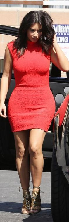Who made  Kim Kardashian's red mini dress and and gold lace up sandals that she wore in Van Nuys on March 14, 2014?