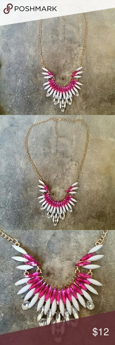 Pink, White, & Clear Rhinestone Statement Necklace Dark fuchsia pink, milky white, and clear diamond resin  rhinestones set in super shiny gold metal, collar length necklace. The main part is in three sections, as shown in pics, so that it sits properly when wearing, and is 3.5 inches long, 3 inches wide at the very top. Overall open length is 17 inches, plus another 1.5 inches of extension chain.   NEW, never worn, no tags.   Thank you for checking out my closet, and happy poshing!! :)…