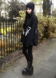 in all black - outside - baggy clothes - platform shoes - tight jeans - leggings - beanie - long black hair