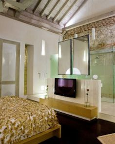 In Ziberline rooms, exposed brick and other industrial elements counter feminine touches. #Jetsetter