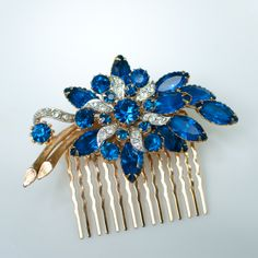 Multitiered rhinestones of aqua, emerald green and dark blue. Perfect for a peacock themed wedding! It is @ 2 in diameter and set on a gold plated secure comb. A vintage piece in excellent condition. Vintage Hair Combs, Romantic Flowers, Vintage Rhinestone, Jewel Tones, Vintage Hairstyles, Sapphire, Jewels, Unique Jewelry, Handmade Gifts