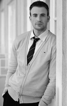 Chris Evans pulls this look off and so can you. The tie knot is loosened but not 'undone'. The cardigan makes the outfit - spend the money there, match items from your existing wardrobe - black slacks, tie, white dress shirt. Important: Collar tips must look GOOD, no buttons and no crinkles. There are plastic tags there for a reason, do not remove. :)