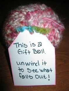 gift ball using yarn.  Wrap gift up inside the ball.  What a hoot!  Have to do this.  Hang these on the Christmas tree!!!.