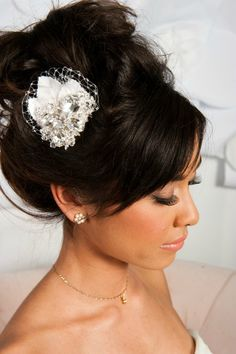 Love this up-do because it's so high up on her head and it has the pretty little flower pin to add a little something.