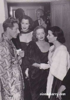 Vivien Leigh, Bette Davis and Kitty Carlisle are visiting Danny Kaye backstage or maybe in his dressing room.