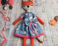 This little fox is totally handmade. I used soft blended felt for her body and cotton fabric for her lovely dress. Body is stuffed with non-allergic hollofayber. Face is hand embroidered. Height is (approx.) 14 (35 cm).  Perfect as home decor, nursery decor, or a lovely gift.  May not be washing machine safe. Dry clean only.  Delivery time 7-45 days. Read shipping policy here http://www.etsy.com/shop/MiracleInspiration/policy  Made in non-smoking area!! Thanks so much for visiting my shop