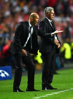 Carlo Ancelotti looks on as Zinedine Zidane shouts instructions during the UEFA Champions League final match between Real Madrid CF and Club Atlético de Madrid at Estadio Da Luz on May 24, 2014 in Lisbon, Portugal.