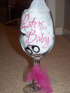 Laters, Baby - 50 Shades of Grey Wine Glass Pink and Black With Handcuffs. $12.00, via Etsy.