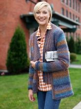 This cozy stockinette cardigan is trimmed with a whimsically asymmetrical neckband worked in garter stitch.