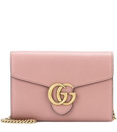 Gucci - GG Small leather shoulder bag - With an opulent antique gold-tone logo placed front and centre, Gucci's GG Small leather shoulder bag is an iconic way to smarten up your outfits. The understated blush leather looks especially glamorous next to beige and black hues alike. With its multiple slots and compartments, it easily doubles as an elegant clutch on evenings out. seen @ www.mytheresa.com