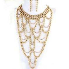 Rhinestone & Gold Fashion Necklace & Earring Set Torso length gold necklace and long earring set. Necklace has sparkle to it. Brand new. Never worn. Jewelry Necklaces