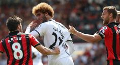 Marouane Fellaini clashes with Harry Arter