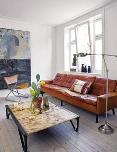 Light tone and texture of couch (not style) meet wood and sleek lines