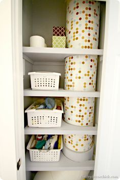 Linen closet laundry chute: I love her idea of putting colored contact paper/shelf liner on it!  via Thrifty Decor Chick