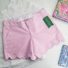 LILLY PULITZER The Buttercup Short lilly pulitzer the buttercup short  ⠀† size 000 ⠀† color/print: pb pink fancy seersucker stripe ⠀† zipper closure ⠀† feminine scallop hem detail ⠀† zip fly short with hook and bar closure ⠀† slant front pockets and back welt pockets ⠀† 89% cotton, 11% polyester ⠀† new with tags  host pick! ⠀3.25.16 › casual chic  disclaimer: ⠀✗ i do not trade ⠀✗ no lowballing ⠀✓  price firm unless bundled Lilly Pulitzer Shorts