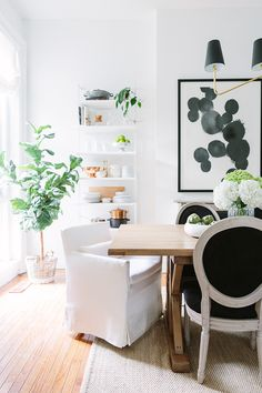 Super idea!  Open shelving in dining room to hold extra pots, pans, cookbooks, plates, cups  The Everygirl Cofounder Alaina Kaczmarski's Greystone Home Tour | The Everygirl