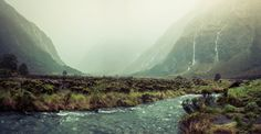 It was a bleak day for sure, but I really like the mood of this photo. It was literally my first day using the Hasselblad, and I didn't quite have the lens I wanted to get in the whole valley. So I made a series of horizontal shots and stitched them all together later in Photoshop. - Milford Sound, New Zealand - Photo from #treyratcliff Trey Ratcliff at http://www.StuckInCustoms.com