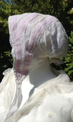 c1810 soft bonnet of white dimity with pink ribbon. Books of the whole Sylvestra Regency Fashion collection available! http://www.blurb.co.uk/search/site_search?search=sylvestra+regency