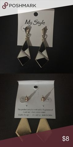 Black and White Geometric Dangle Earrings White and black geometric dangle earrings. I am not sure of the metal type. I have multiples so let me know if you want more than one! Jewelry Earrings