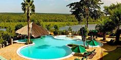 Safari I Swimming pool with views of  River Nile at Paraa Safari Lodge. Book your Ugandan Safari to Muchison Falls National Park with us info@kagerasafaris.com