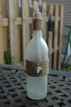 Frost Me in Twine Wine Bottle Oil Candle with twine and silver pendant. $20.00, via Etsy.