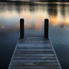 Late evening at the waters edge, the evening is still and the presence of the dock comforting.