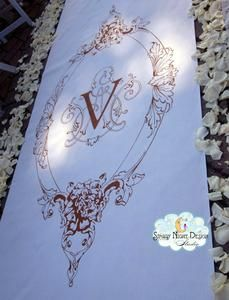 A vintage crest on the wedding aisle runner can elevate the ceremony to majestic. #springaislerunners, #vintageweddingaislerunners